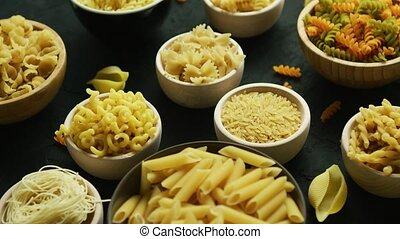 Different kinds of macaroni put in bowls - From above view...