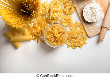 Different kinds of pasta on a white background