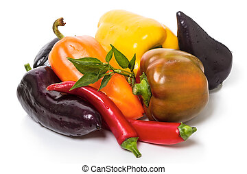 Different kinds of pepper on white