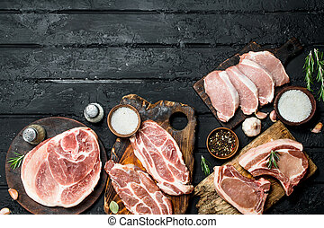 Different kinds of pork meat with spices.