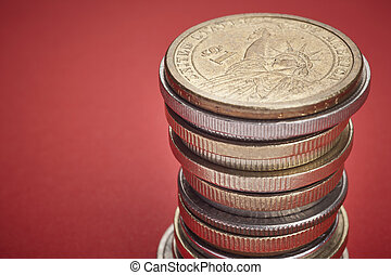 Different kinds on coins over a red background. Macro detail
