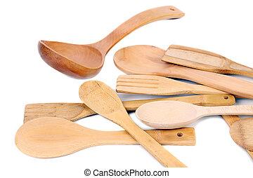 Different kitchen wooden utensils cutlery.