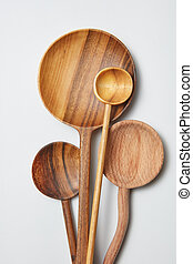 different kitchen wooden utensils on a white background on a...