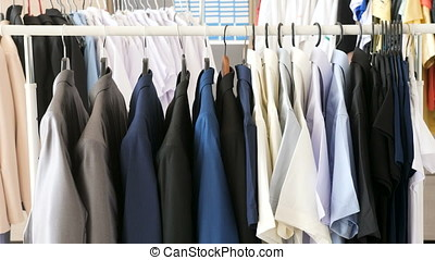 Different male business clothes, including suits and shirts...