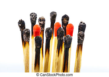 different matches - many burned matches and new side by...