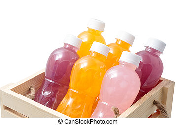 Different of healthy drinks in plastic bottles on white background