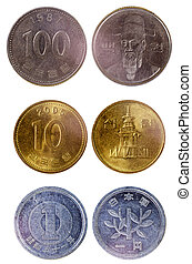 different old japanese coins isolated on white background
