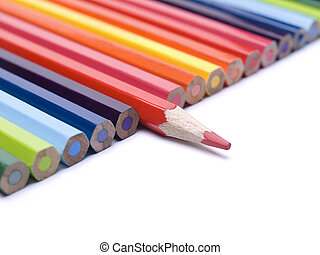 Different pencil - A red pencil comes out from the row of...