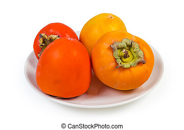Different persimmon fruits on dish on white background close-up