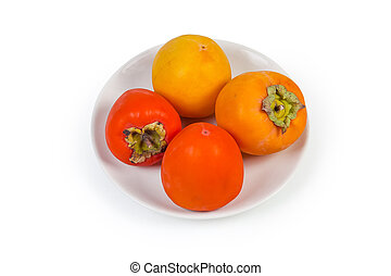 Different persimmon fruits on white dish on a white background