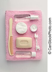 Different personal hygiene objects on white and pink turkish...