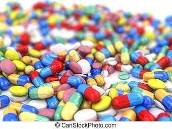 Different pills and capsules placed on a table, with shallow...