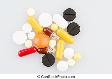Different pills on the medical table