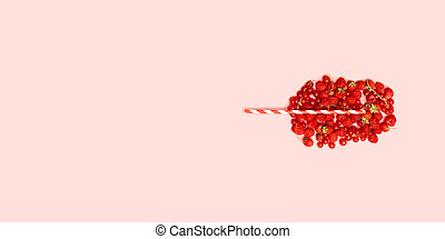 Different red ripe berries in the shape of a glass with fruit juice and a straw. Summer fruit concept pattern.