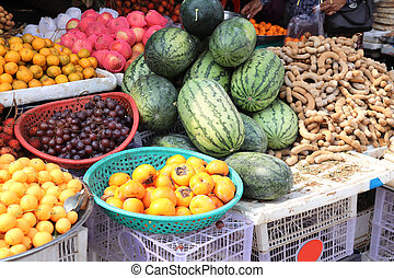 Different ripe fruits in street market, Cambodia