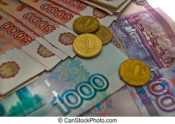 Different Russian banknotes and coins background