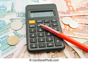 banknotes, coins, pen and calculator