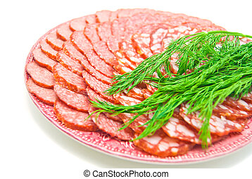 different sausage with herbs on plate