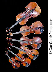 different sized fiddles on black
