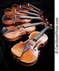 violins with black background
