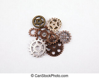 Different sizes and colored gears on a white background