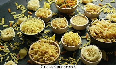 Different sorts of macaroni in bowls - From above view of...