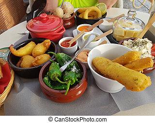 Different Spanish tapas.