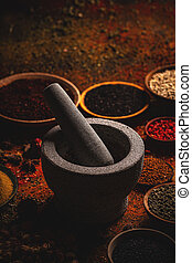Different spices and mortar