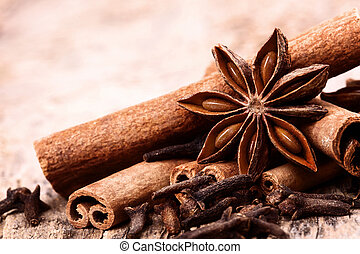 Different spices, Cinnamon, anise on wooden old table