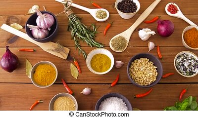 different spices for cooking on wooden table - food,...