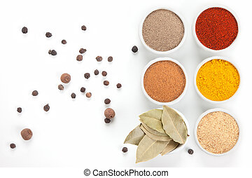 Different spices in white bowls isolated on white background...
