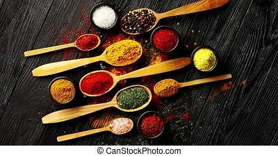 Different spices placed in spoons - From above view of ...