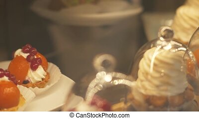 Different sweet cakes in bakery cafe close up. Confectionery...