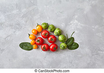 Different tomatoes and spinach leaves