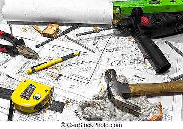 Different tools and blueprints are lying on carpenter...