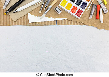 tools for drawing: watercolor paints, paintbrushes, colored chalks and pencils