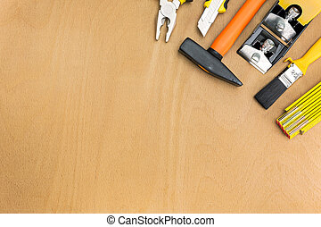 Different tools on a wooden background