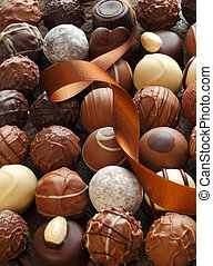 Truffles - Different Truffles with a brown ribbon as a ...