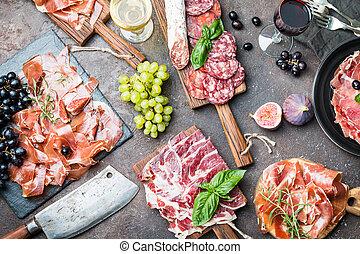 Traditional Spanish ham - Different types jamon on cutting...