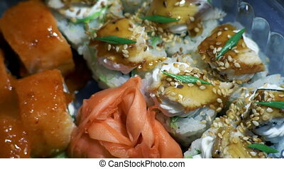 Different Types of Appetizing Sushi in Plastic Containers -...