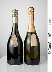 Different types of champagne on a light background. Side view.