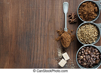 Different types of coffee on a wooden background