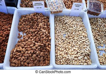 Different types of delicious nuts for sale at Sunday market in Spain, Mercadillo de Campo de Guardamar