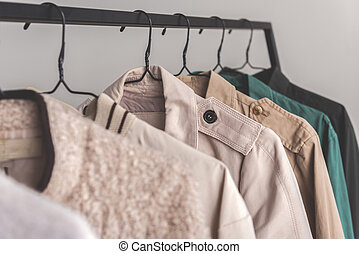 Different types of overcoats in wardrobe