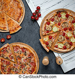 different types of pizza on the table 1