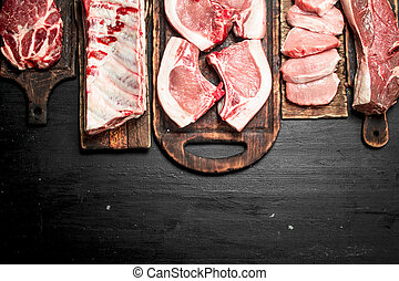 Different types of raw pork meat and beef.