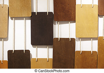 Different types of wood hanging on the wall