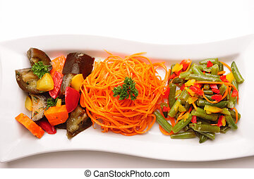 Different vegetable salads on plate.