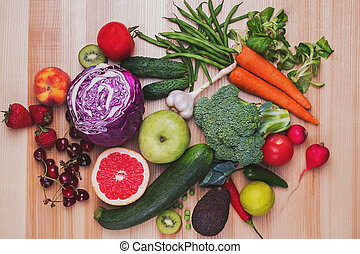 Different vegetables and fruits on the wooden table