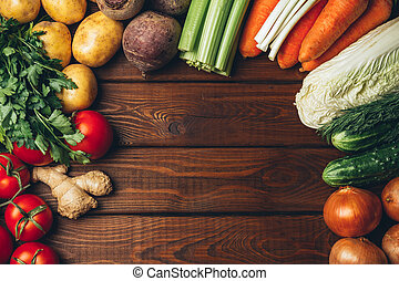 Different vegetables on old wooden table